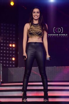 (old pic) Shraddha Kapoor, rockstar fashion hip in black tight pants, heels, cropped halter top with gold threads. Indian Bollywood Actress, Bollywood Girls, Beautiful Bollywood Actress, Most Beautiful Indian Actress, Bollywood Stars, Bollywood Celebrities, Bollywood Fashion, Indian Actresses, Indian Celebrities