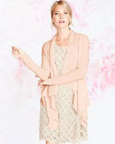 Our dramatically draped cashmere cardigan is long on stylish details — mitered corners, visible seaming — that make a standout sweater. Even better in a finer gauge, it comes in cool neutrals and classic black. Pair it with our Classic Lace Dress for a feminine look.