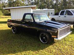 Black Chevrolet c10 truck