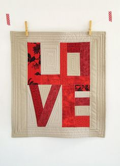 Custom Love art quilt / wall hanging / modern patchwork / decorative mini quilt / table topper/ Red mini quilt. $55.00, via Etsy. Could make your own as well!