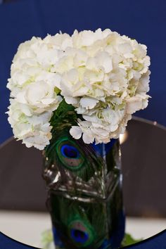 On table where guests sign guest book? I already have two vases like this.