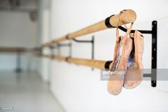 Ballet shoes hanging on wooden barre. Pair of ballet slippers hanging. Ballet Barre, Ballet Shoes, Dance Shoes, Pole Dance Moves, Pole Dancing, Running Training, Running Tips, Boot Camp Workout, Runners World