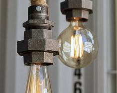 Items similar to The Set Sail Pendant Light - Rustic Wooden barn Pulley lamp - Industrial Hanging lighting - Ceiling Rope fixture edison bulb on Etsy Pulley Pendant Light, Rustic Pendant Lighting, Cabin Lighting, Chandelier Lighting, Wooden Barn, Metal Barn, Steel Canopy, Large Chandeliers, Hardware