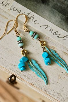 Bohemian feather. blue feather,rhinestone, turquoise, boho feather earrings. tiedupmemories