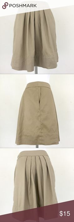 LOFT Khaki Pleated A-Line Skirt •Size: 2P •Color: Khaki •Material: 97% Cotton 3% Spandex •Lining: Unlined •Closure: Hidden Side Zipper •Details: Side Pockets •Care: Machine Wash All measurements are in inches and taken with garment lying flat:  •Waist: 13 •Overall Length: 18 1/4 Item: 245_63 LOFT Skirts A-Line or Full