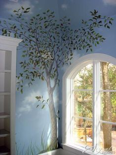 tree painted in corner with open sky, good way to open up a room. check out pinterest for ideas/inspiration.
