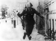 East German Soldier named Hans Conrad Schumann who famously defected to West Germany during the Construction of The Berlin Wall in 1961 •