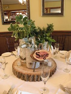 """""""Natural"""" wedding centerpieces. Different herbs beautifully displayed. Clever."""