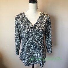Black and White Faux Wrap Top Soft and comfortable faux wrap top. 94% Polyester, 6% Spandex. Size is Petite Large.  No Trades Briggs New York Tops