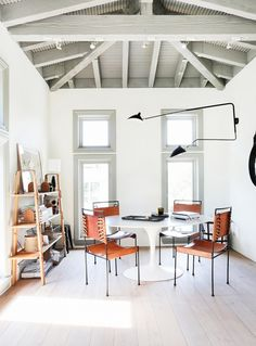 Leather chairs around small dining space in eating area with exposed ceiling beams