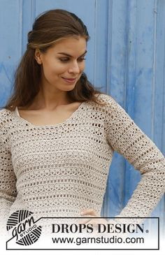 Crocheted sweater with lace pattern. Sizes S - XXXL. The piece is worked in DROPS Cotton Light.