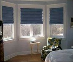 Awkward Shaped Windows Such As Bay Windows Require Extra Thought. Here A  Set Of Roman Shades Allows Flexible Light Control For A Large Bay Window.