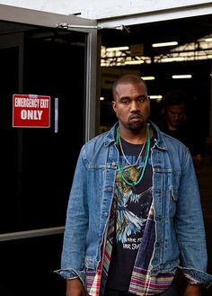 Kanye West at Wang (...he's smiling on the inside).       #NYFW #Spring2014 #StreetStyle
