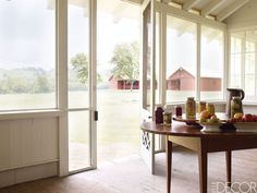 Renowned landscape architect Ben Page and his wife, Libby, went back to their Tennessee roots in this country retreat. The screened porch's cedar floor and wall panels are from a local Mennonite sawmill, and the 19th-century table is from Kentucky.