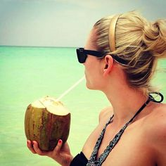 Drinking fresh coconut milk. Isla Saona, Dominican Republic - 2015