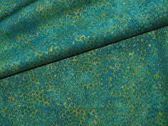 ein wunderbarer Stoff von Northcott aus der Serie Artisan Spirit shimmer. Der Stoff sieht aus als würden blaugrüne fast petrolfarbene unregelmäßig große Bläschen auf einem goldenen Hintergrund...