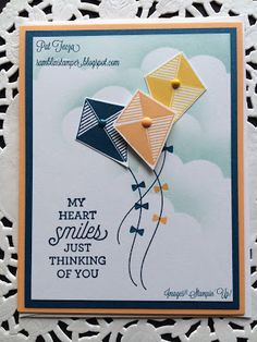 handmade greeting card from the Ramblin' Stamper ... Swirly Bird kites with bow on their strings ... sponged cloudy sky ... blue, yellow, white ... great card ... Stampin' Up!