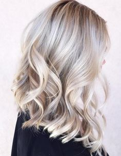 Darker roots at the crown are faded among hints of platinum blonde, A stunning…