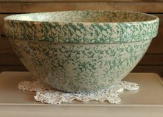 Beautiful and heavy pottery bowl made in Roseville, Ohio, by Ransbottom Pottery. Glazed in green sponged over an ivory-yellow base.