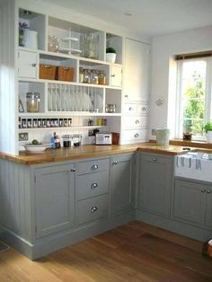 Ikea kitchen cabinets as entertainment center 2 like how the shelf side extends all the way . ikea kitchen cabinets as entertainment center Small Space Kitchen, Kitchen Corner, Ikea Kitchen, Kitchen Flooring, Kitchen Decor, Kitchen Ideas, Kitchen Sinks, Small Spaces, Kitchen Shelves