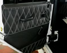 Landrover Defender custom door cards designed by staff at Ruskin Design with white stitch diamond quilted.www.ruskindesign.co.uk