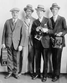 Another men's style photo, this one depicting 1920's men's fashion history.  We cannot forget the importance of men's hats. Pictured left to right a newsboy cap, felt Homburg, Homburg again, and Fedora hat. http://www.vintagedancer.com/1920s/1920s-mens-fashion-history-begins