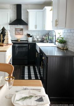 Black and White Kitchen at Christmastime. Part of the 2020 Christmas Home by Hymns and Verses blog.