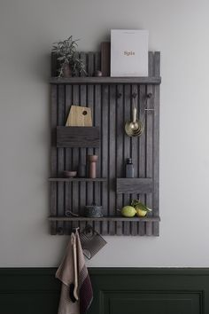 Keep order in your everyday essentials with this Multi Shelf. With practical pockets and knobs, you can easily sort out your keys and credit cards in the hallway, use it in the office for paper and stationery, or wherever else you find yourself in need of an organising hand. Made of black-stained ash wood slats, it preserves a natural expression that seamlessly blends into a modern interior, making your life a little easier, one knob at a time.