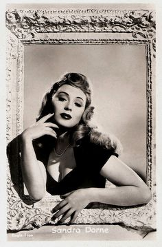 """""""British actress Sandra Dorne (1924-1992) was a sexy and glamorous bombshell. She was a popular pin-up early in her career, played leads in the 1950s and later appeared in supporting roles."""""""