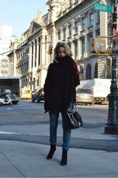 Elin kling wearing comfortable black boots with a perfect dark sweater for the fall season.