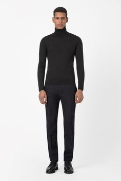 JACQUARD TROUSERS These slim-fit tailored trousers are made from modern jacquard fabric with a tactile raised texture. Tapering slightly towards the ankle, they have a classic zip fly fastening, slanted pockets and crisp press folds along the front.