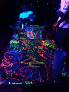 tables covered in black paper for kids to write on.  pros and cons to this one!