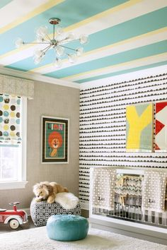 """Designer Karen Wolf's clients had purchased a dotted Roman window shade for their gender-neutral nursery and wanted to build from there. Wolf, based in South Orange, New Jersey, turned the room more """"boy"""" when the couple learned they were expecting a son. (via Parents.com) #nursery #style #decor #ideas"""