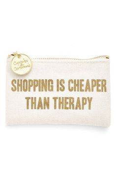 "A whimsical coin purse with a ""Shopping Is Cheaper Than Therapy"" stamped in gold is the perfect accessory."