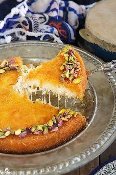 Mozzarella Cheese Kunafa This recipe breaks some cheese Kunafa-making rules, but the result is one of the best you'll ever have! A simple trick keeps the cheese filling from hardening even after it has cooled down. Lebanese Desserts, Lebanese Recipes, Turkish Recipes, Persian Recipes, Knafeh Recipe Lebanese, Lebanese Cuisine, Arabic Dessert, Arabic Sweets, Arabic Food