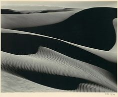 Dunes, Oceano, by Edward Weston (1936). Weston's nudes and dunes share so much:  sinuous shapes, beautifully arranged swaths of tones, even the letters of the words themselves ;)