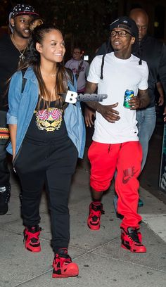 Lil Wayne and Christina Milian take romantic stroll on the streets of Philadelphia, PA. The couple look happy in love, holding hands and hugging.