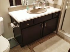 How To Paint Bathroom Cabinets Espresso painting builder grade bathroom cabinets behr paint and primer mix