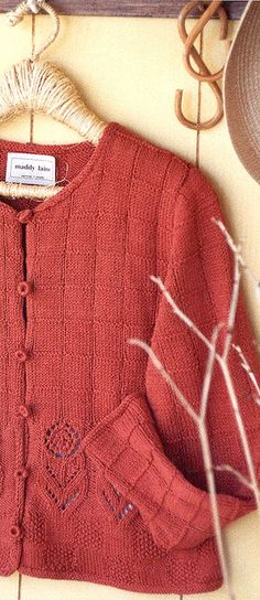 A maddy laine knitting pattern for a cropped-length summery cardigan with set-in sleeves, crochet-covered buttons, and I-Cord edging for a neat finish. Purl Stitch, Seed Stitch, Jumpers For Women, Cardigans For Women, Knit Cardigan, Summer Cardigan, Knit Sweaters, Cotton Cardigan, Knitted Flowers