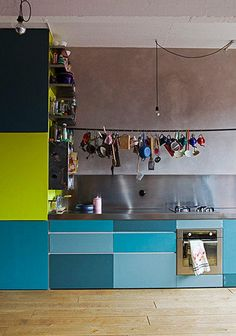 love all the colorful hanging pots and pans and the color block cabinets! not this isn't brooklyn, it's paris.  maisonbd3