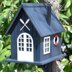 Painted Bird Houses for $66.99 with Free Shipping! Cute boat house bird house with exceptional detail and entrance in life saver.