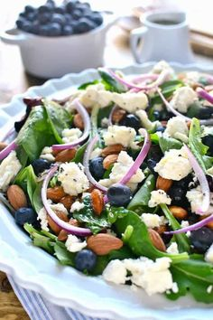 Blueberry Feta Salad is your new go-to salad recipe for spring! It combines blueberries with feta cheese, almonds, and a lemon poppy seed vinaigrette dressing.