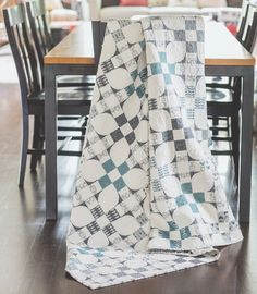 FLOWERING NINE-PATCH by Amy Ellis: Do you see flowers, Nine Patches, or Churn Dash quilt blocks? Using only white and shades of gray, Amy Ellis has created a quilt with strong visual interest.