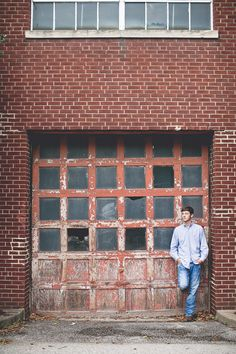 senior photography, senior picture ideas, senior boy poses, industrial background setting, simple and clean, byshea, shea wright, byshea photography