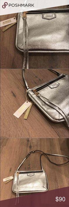 Aimee Kestenburg crossbody silver purse Super cute silver Aimee Kestenburg cross body purse. NWT.never used Aimee Kestenberg Bags Crossbody Bags