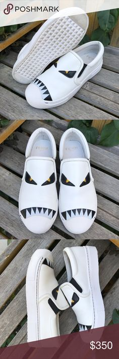 FENDI White Monster Eyes Slip-On Shoes It's always interesting to see what new product Fendi comes up with, like these monster slip on this. This is actually the only pair in white I've ever seen. Unfortunately because they are white they do show dirt/scrapes. As you can see there is some where, a good cleaning would probably do wonders. Please view all photos and feel free to ask me any questions before purchasing. Size 36. Fendi Shoes Flats & Loafers