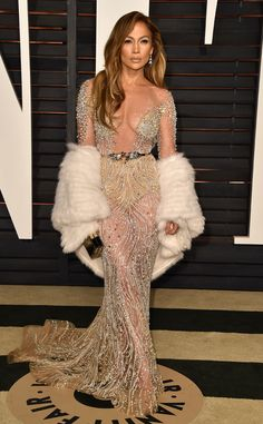 Jennifer Lopez from 2015 Oscars After-Party Looks (Plus Viewing Parties!)  In Zuhair Murad Couture. Same old same old, JLo, neck plunging deep into the South Pole. We get it! You have a fantastic body but you don't need to show it all every time.