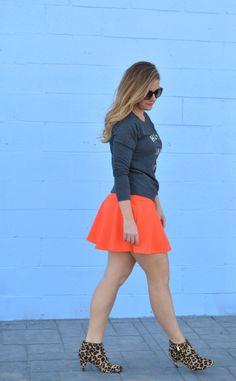 Graphic sweatshirt, orange flare skirt, leopard booties on www.sophisticaited.com