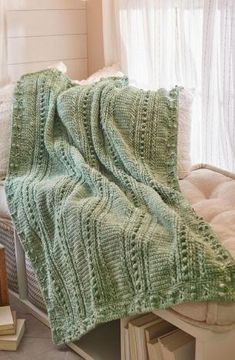 Whether you're looking for a cuddly throw for cold winter nights or a blanket that will keep you warm in those early days of spring, you can't go wrong with this Comforting One-Color Crochet Throw! The intermediate crochet throw pattern features an elegant and timeless design that is stunning.