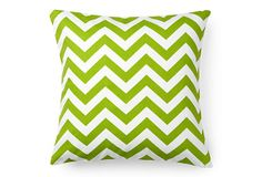 A perfect way to bring a chevron pattern into your home is this green and white patterned pillow.